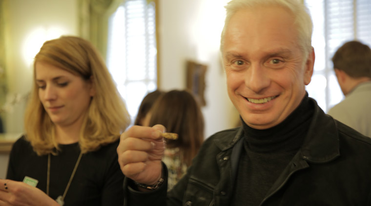 Jonathan Ford, Pearlfisher's Founding Creative Partner gives a crunchy, dried cricket a go at Taste Mode London.